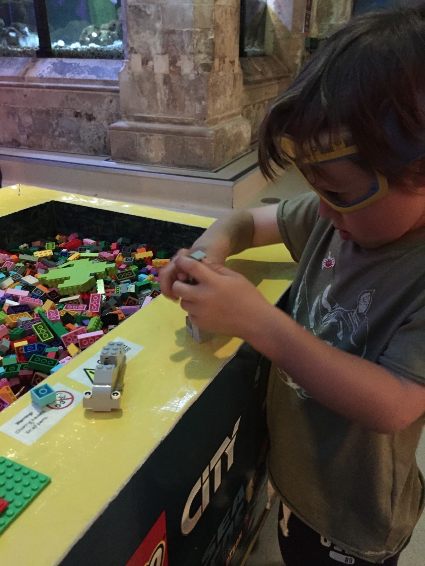 J with Minion glasses in the Lego section